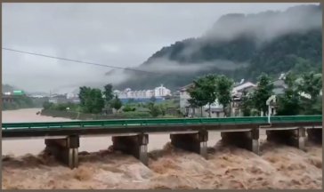 The Qingxigou Bridge was partially destroyed as a result of flooding in Wuduhe Town, Yichang, China on the morning of June 17, 2021