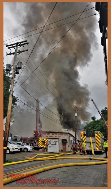 McKeesport PA USA 3 alarm structure fire 7/16/21. Started after high tension wires fell on the roof of an auto body shop after a thunder storm and the power company couldn't get the power off. Crews had many water supply issues resulting in multiple tankers being called. Photo credit FirstDuePhoto