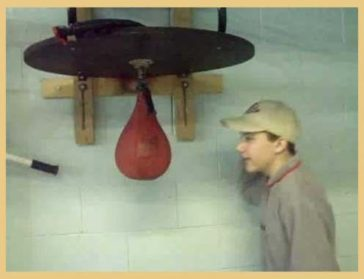 Kid gets owned by Punching Bag