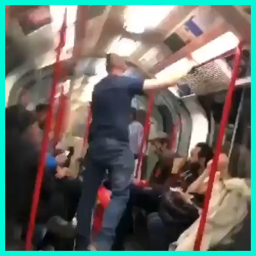 Young woman being threatened by drunk man on central line in London & bunch of guys come to the rescue